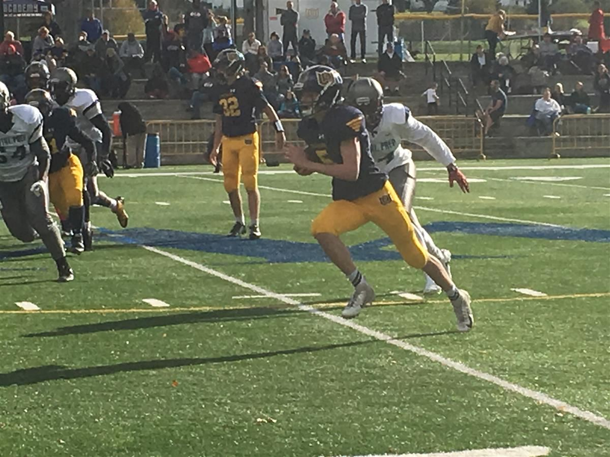 Woodstock Academy quarterback Nick Bedard runs with the football
