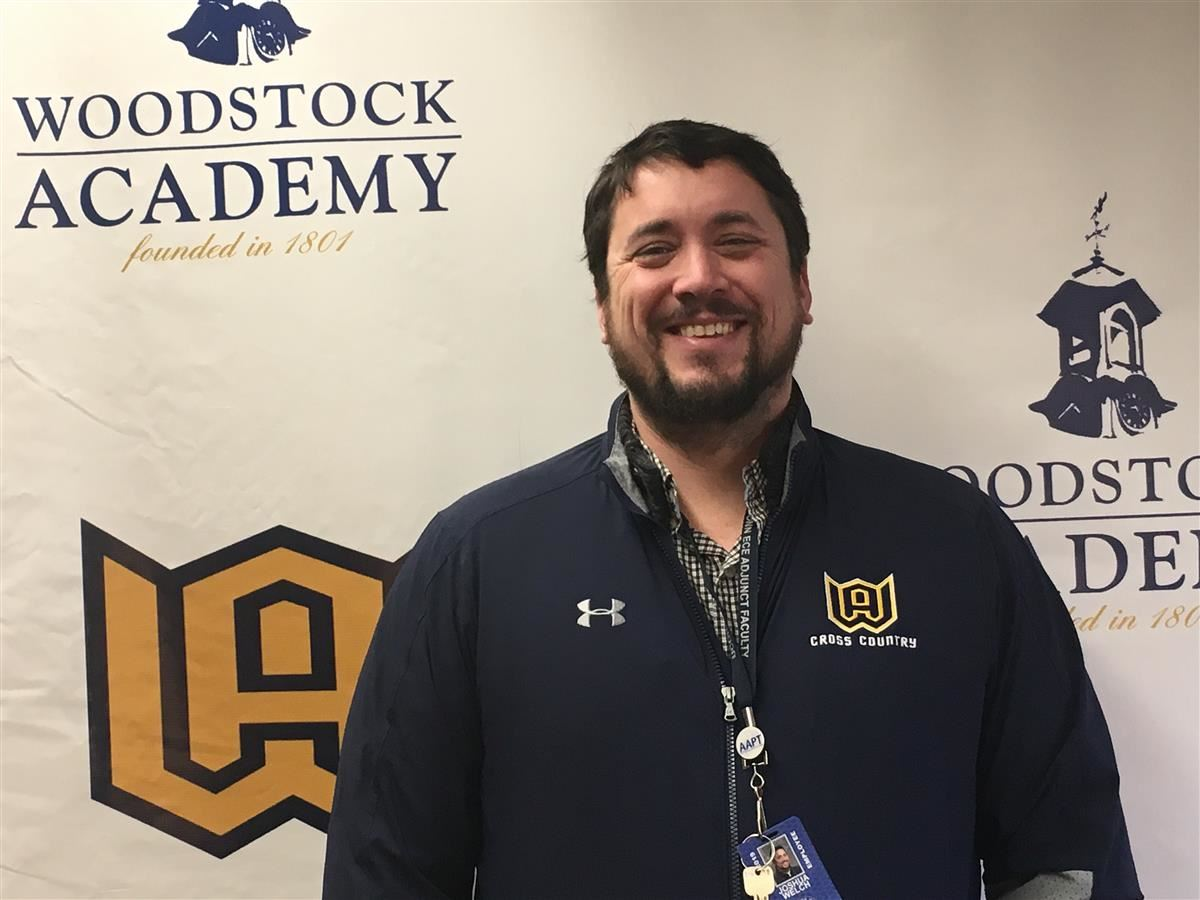 Woodstock Academy girls indoor track coach Josh Welch