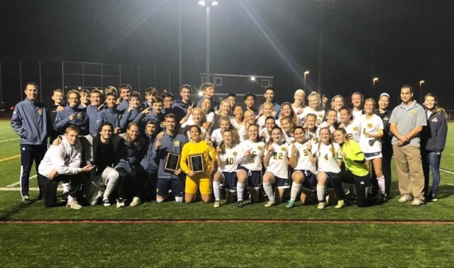 Woodstock Academy's boys and girls celebrate ECC soccer championships