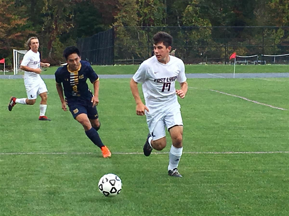 Woodstock Academy's Eric Phongsa tries to track down the ball against East Lyme's Kane Salan