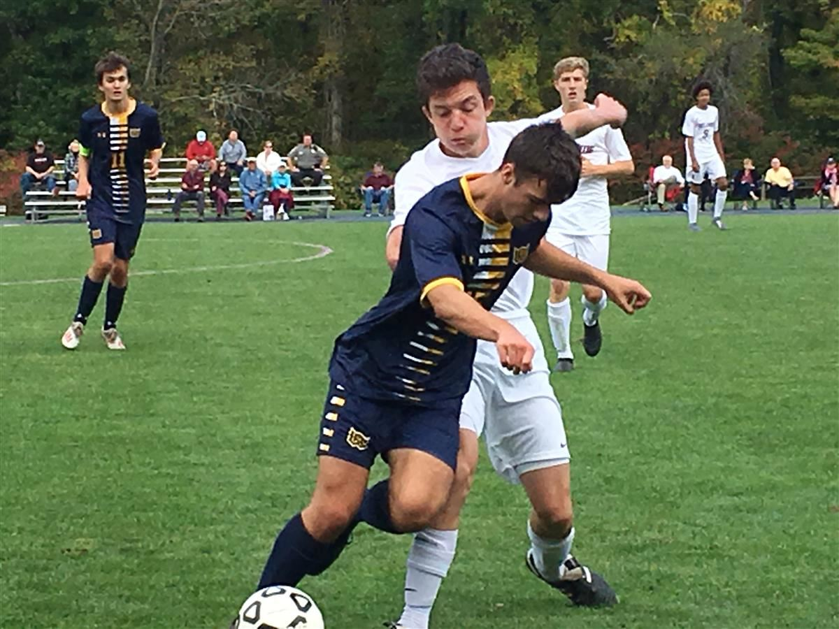 Woodstock Academy's Chad Graley works the ball against East Lyme