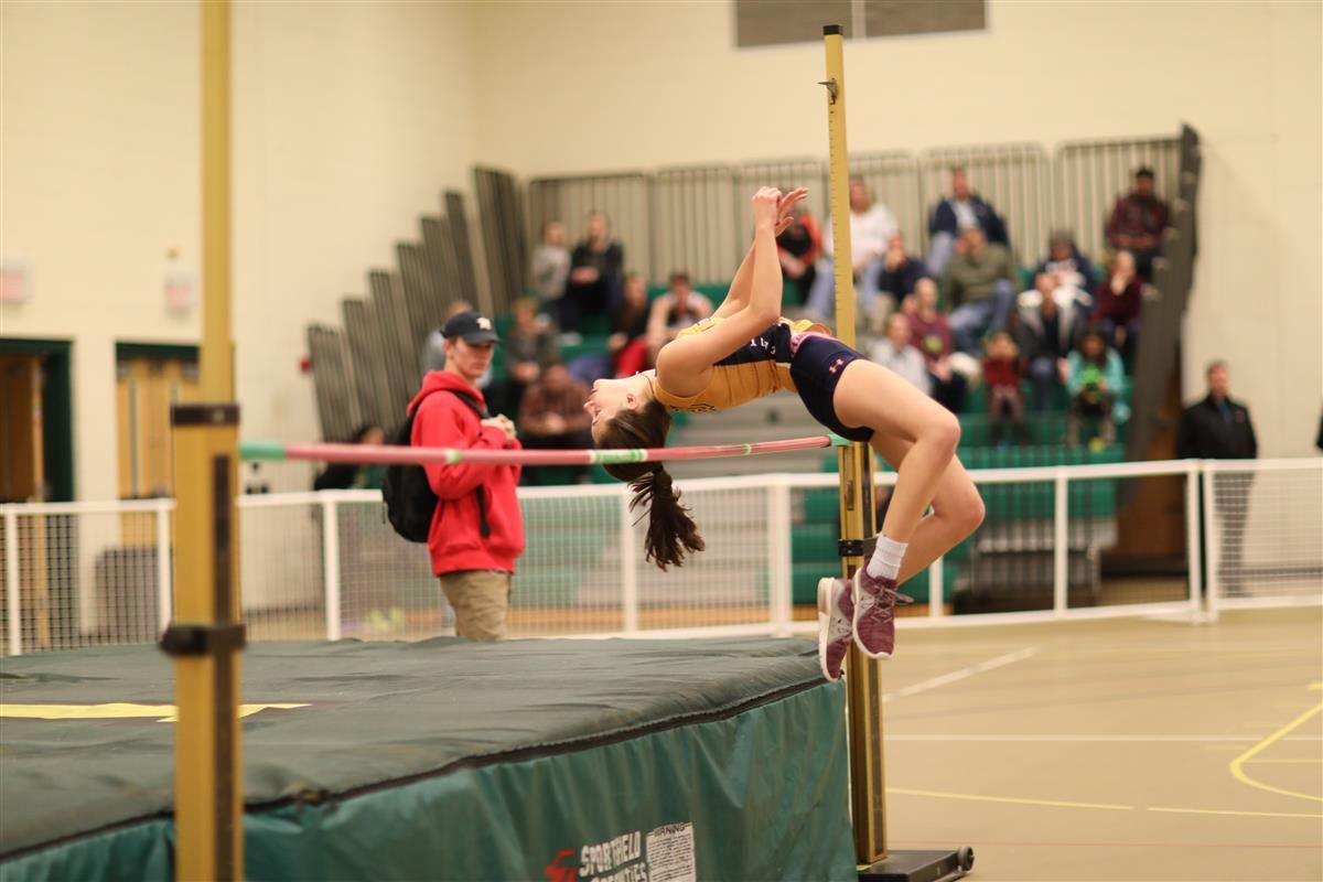Girls indoor track high jumper