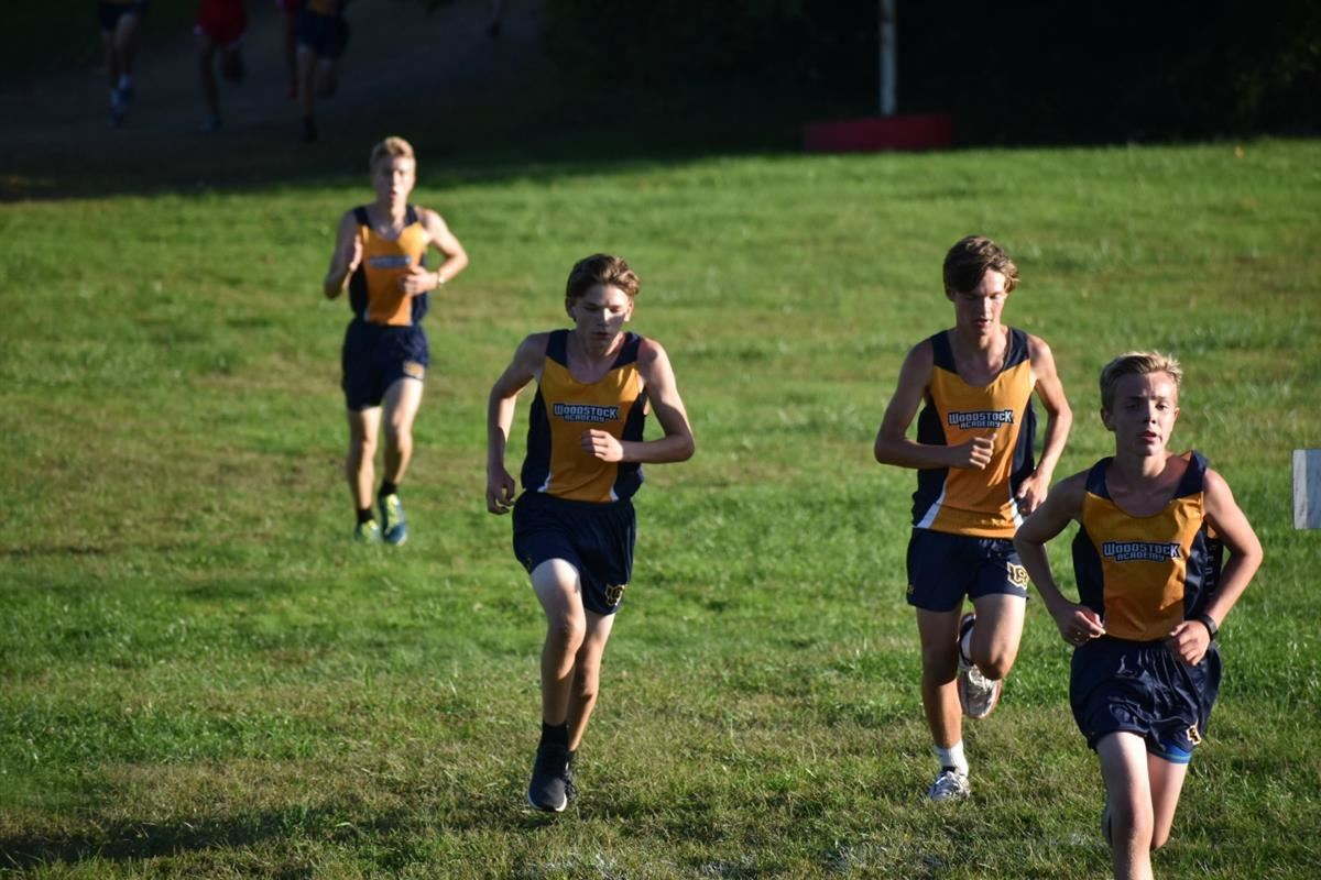 Members of the Woodstock Academy boys cross-country team run against Ledyard and NFA